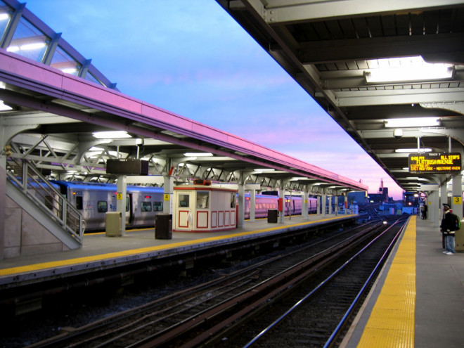 1280px-Jamaica_station_sunset,_waiting